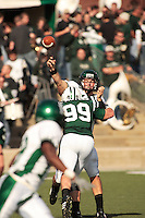 Andy Schmitt passes the football just at Ohio's Curtis Meyers gets to him during the 2nd half of their game against Ohio university. Ohio won their homecoming game 48 42..Eastern Michigan Football vs. Ohio University, 10132007Eastern Michigan Football vs. Ohio University, 10132007