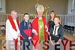 Pupils Darragh Leahy and Michella  Barrett  from Scoil Chriost Ri, Dromnacurrow, Causeway after they were confirmed at St. John's Church, Causeway, by the Bishop of Kerry Ray Brown and Fr. Brendan Walsh, PP Causeway and Ballyduff on Monday with Teacher  Regina O'Connor