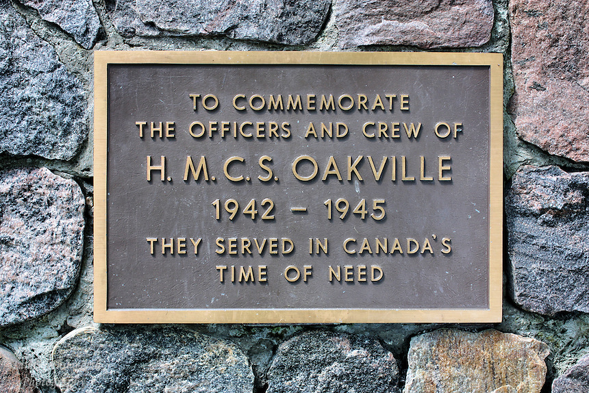 A plaque is displayed by the lake in Oakville to commemorate the officers and crew of the HMCS Oakville from World War II