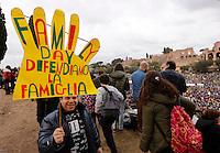 "Manifestazione ""Family Day"" al Circo Massimo, in sostegno della famiglia tradizionale, contro la legge sulle unioni civili in discussione al Senato, Roma, 30 gennaio 2016. <br /> A demonstrator holds a sign reading ""Family Day. Let's defend family"" at the Circus Maximus during the ""Family Day"" rally in support of traditional family, against civil unions proposed law in discussion at the Italian Parliament, Rome, 30 January 2016.<br /> UPDATE IMAGES PRESS/Riccardo De Luca"