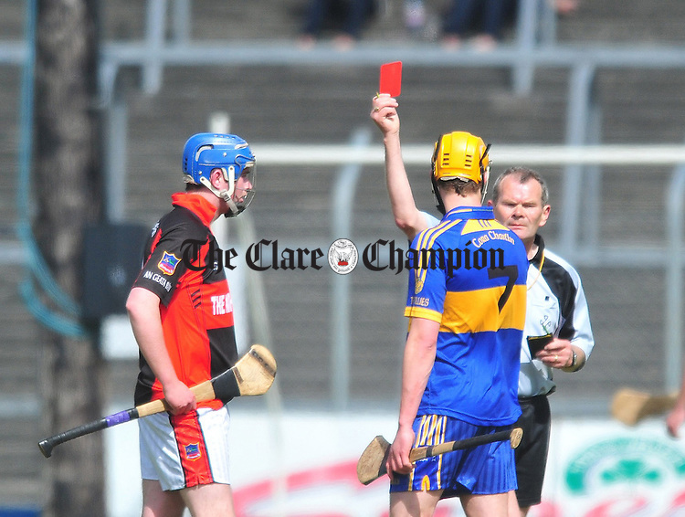 Shane O' Rourke of Whitegate and Newmarket's Alan Barrett see red during their senior hurling championship clash at Cusack Park. Photograph by Declan Monaghan