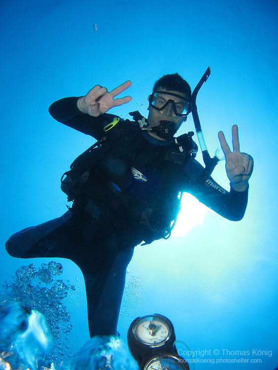 Qixingyan ('Seven Star Rock'), Taiwan -- Diver in the blue vastness of the Pacific Ocean.
