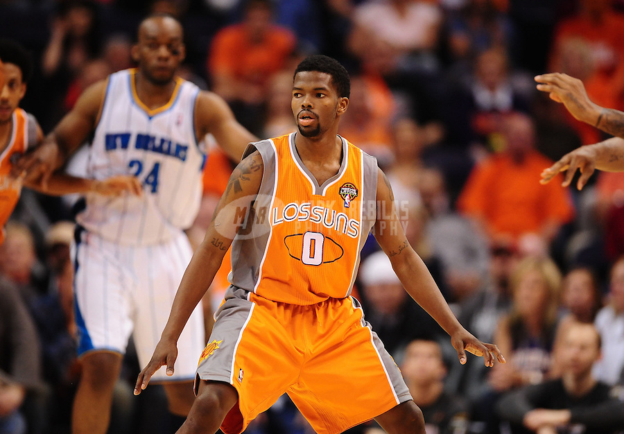 Mar. 25, 2011; Phoenix, AZ, USA; Phoenix Suns guard (0) Aaron Brooks against the New Orleans Hornets at the US Airways Center. The Hornets defeated the Suns 106-100. Mandatory Credit: Mark J. Rebilas-