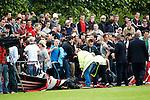 Nederland, Amsterdam, 27 juni 2012.Seizoen 2012/2013.Eerste Training Ajax 2012.Supporters van Ajax vallen door de dranghekken heen.
