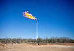 A natural gas burnoff flare ignites on a Goodrich Oil Company field  on the Burns Ranch near Dilley, Texas on Tuesday, January 3, 2012. Oil and natural gas companies often burn excess natural gas that is coincidentally extracted from oil rig fracking. ..Ben Sklar