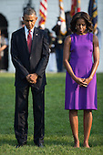 United States President Barack Obama and First Lady Michelle Obama, observe a moment of silence for the 12 anniversary of the 9/11 terrorist attacks, at the White House on September 11, 2013 in Washington, D.C. <br /> Credit: Kevin Dietsch / Pool via CNP