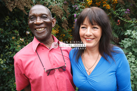 Elderly black man with white woman carer