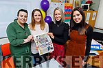 Aisling O'Connell, Aoife O'Sullivan, Joanne Casey and Grace Crowley reading a copy of Kerry's Eye from 1995 which was in the time capsule, opened on Friday at the school