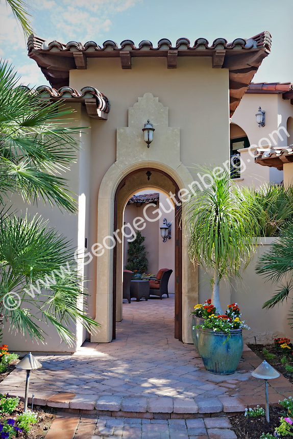 Arched door leads to courtyard