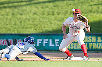 Great Lakes Loons first baseman Matt Jones (40) catches a pickoff throw to first base as South Bend Cubs baserunner Andrew Ely (8) dives back to first on May 18, 2016 at Dow Diamond in Midland, Michigan. Great Lakes defeated South Bend 5-4. (Andrew Woolley/Four Seam Images)