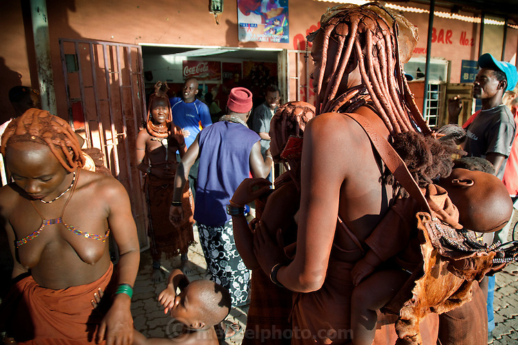 Namibians of various ethnicities mingle at Castle Bar Number 2 in Opuwo, northwestern Namibia on a weekday afternoon. (From the book What I Eat: Around the World in 80 Diets.) Alcohol flows freely for those who can afford it, while those who can't try to solicit passersby for money, tobacco, and beer.