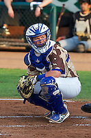 Austin Cowen (15) of the Ogden Raptors behind the plate as the Raptors faced the Great Falls Voyagers at Lindquist Field on August 16, 2013 in Ogden Utah. Military Appreciation Night saw the Raptors take the field in camouflage uniforms. (Stephen Smith/Four Seam Images)