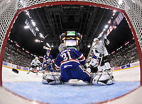 At left, the pucks sails past Rochester Americans goaltender Nathan Lieuwen for a San Antonio Rampage goal in the second period of an AHL hockey game, Saturday, Jan. 18, 2014, in San Antonio (Darren Abate/AHL)