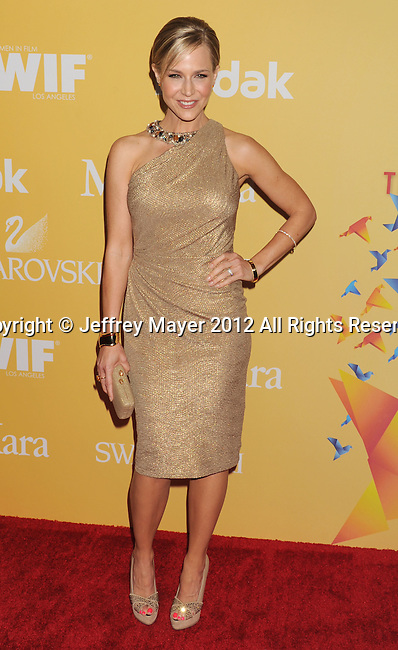 BEVERLY HILLS, CA - JUNE 12: Julie Benz  arrives at the 2012 Women In Film Crystal + Lucy Awards at The Beverly Hilton Hotel on June 12, 2012 in Beverly Hills, California.
