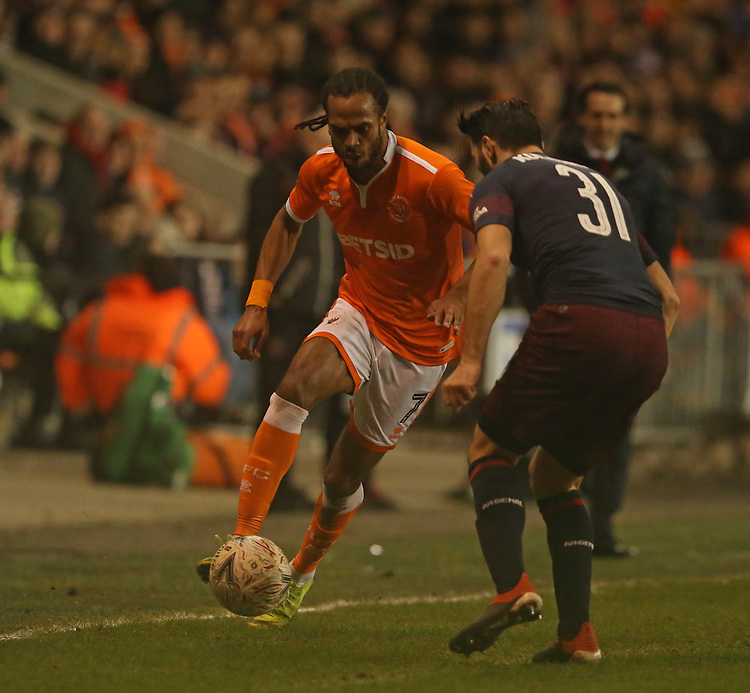 Blackpool's Nathan Delfouneso and Arsenal's Sead Kolasinac<br /> <br /> Photographer Stephen White/CameraSport<br /> <br /> Emirates FA Cup Third Round - Blackpool v Arsenal - Saturday 5th January 2019 - Bloomfield Road - Blackpool<br />  <br /> World Copyright &copy; 2019 CameraSport. All rights reserved. 43 Linden Ave. Countesthorpe. Leicester. England. LE8 5PG - Tel: +44 (0) 116 277 4147 - admin@camerasport.com - www.camerasport.com