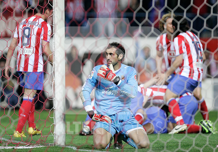 Atletico de Madrid's players celebrate in background as Villareal's Diego Lopez is dejected during La Liga match, March 15, 2009. (ALTERPHOTOS/Alvaro Hernandez).