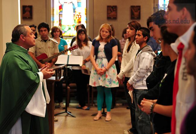 Rev. Joseph Corpora, C.S.C. begins the weekly Spanish Mass at St. Edward's Hall Chapel...Photo by Matt Cashore/University of Notre Dame