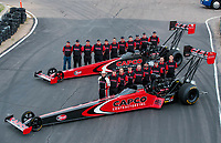 Feb 20, 2020; Chandler, Arizona, USA; NHRA top fuel driver Steve Torrence and his crew poses for a portrait with the dragster and crew of father Billy Torrence during the Arizona Nationals at Wild Horse Pass Motorsports Park. Mandatory Credit: Mark J. Rebilas-USA TODAY Sports