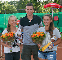 August 9, 2014, Netherlands, Rotterdam, TV Victoria, Tennis, National Junior Championships, NJK,  Prize giving, Richard Krajicek with Gabriella Mujan (R) and Perla Nieuwboer, winners girls  doubles 14 years<br /> Photo: Tennisimages/Henk Koster