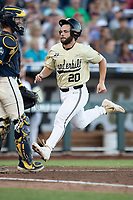 Vanderbilt Commodores designated hitter Ty Duvall (20) crosses the plate against the Michigan Wolverines during Game 3 of the NCAA College World Series Finals on June 26, 2019 at TD Ameritrade Park in Omaha, Nebraska. Vanderbilt defeated Michigan 8-2 to win the National Championship. (Andrew Woolley/Four Seam Images)