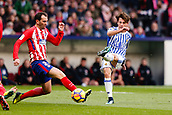2nd December 2017, Wanda Metropolitano, Madrid, Spain; La Liga football, Atletico Madrid versus Real Sociedad; Mikel Oyarzabal (18) of Real Sociedad gets his shot away under pressure from Diego Roberto Godin Leal of Atletico Madrid