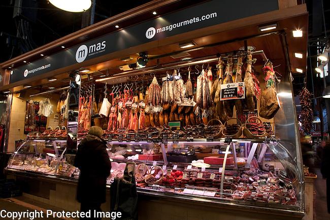 Dried Cured Ham Stall in St Josep la Boqueria Market in barcelona, Catalonia, Spain