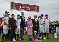 Her Majesty the Queen poses with the winning team 'King Power Foxes' including Thai Chairman of Leicester City Vichai Srivaddhanaprabha (3rd left) and his son and Vice Chairman Aiyawatt Srivaddhanaprabha (King Power Foxes) (4th left) during the Cartier Queens Cup Final match between King Power Foxes and Dubai Polo Team at the Guards Polo Club, Smith's Lawn, Windsor, England on 14 June 2015. Photo by Andy Rowland.