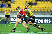 Blade Thomson tackles David Havili during the Super Rugby match between the Hurricanes and Crusaders at Westpac Stadium in Wellington, New Zealand on Saturday, 10 March 2018. Photo: Dave Lintott / lintottphoto.co.nz