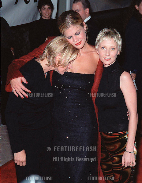 "18SEP99: ""Third Rock from the Sun"" star KRISTEN JOHNSTON (centre) with comedienne  ELLEN DEGENERES (left) & actress ANNE HECHE at PETA's Party of the Century, in Los Angeles.     .© Paul Smith / Featureflash"