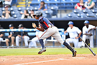 Rome Braves left fielder Justin Ellison (5) runs to first base during a game against the Asheville Tourists at McCormick Field on May 22, 2017 in Asheville, North Carolina. The Braves defeated the Tourists 7-3. (Tony Farlow/Four Seam Images)