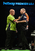 21.05.2015. London, England. Betway Premier League Darts Play-Offs.   Michael van Gerwen [NED] shakes hands with Raymond van Barneveld [NED] after their semi final match.