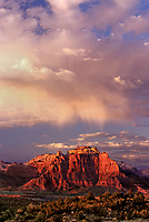 799800020 clearing storm clouds over west temple at sunset view from the back of west temple and zion national park from open rangeland near hurricane utah