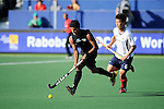 The Hague, Netherlands, June 01: Jared Panchia #14 of New Zealand controls the ball against Namyong Lee #6 of Korea during the field hockey group match (Men - Group B) between the Black Sticks of New Zealand and Korea on June 1, 2014 during the World Cup 2014 at GreenFields Stadium in The Hague, Netherlands. Final score 2:1 (1:0) (Photo by Dirk Markgraf / www.265-images.com) *** Local caption ***