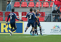 21 April 2012: Chicago Fire forward Dominic Oduro #8 celebrates his goal with Chicago Fire midfielder Logan Pause #12 and Chicago Fire defender Dan Gargan #3 during the first half in a game between the Chicago Fire and Toronto FC at BMO Field in Toronto...