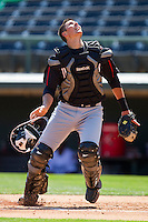 Catcher Mike Blanke #32 of the Kannapolis Intimidators tries to locate a pop fly during an exhibition game against the Charlotte Knights at Knights Stadium on April 3, 2011 in Fort Mill, South Carolina.    Photo by Brian Westerholt / Four Seam Images