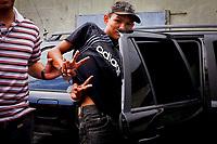 """Manaus 12 08 2011- Menor R.S.B, 17 anos é preso pela policia civil acusado de matar outro menor no bairro da Compensa, zona oeste de Manaus. A série """"guerra esquecida"""", revela uma triste realidade da maior cidade do norte do Brasil. Manaus teve  de 2010 a 2012 mais de  2 mil homicidios de jovens envolvidos com o tráfico de drogas. A igreja católica em fevereiro de 2013 lançou a campanha da CNBB (Conferência Nacional dos Bispos do Brasil), que tem como tema """"Fraternidade e Juventude"""" , o que gerou polêmica na cidade devido ao número de homicidios que o governo do Amazonas não reconhece, ou tenta manipular dados para que não se tenha uma imagem negativa do estado Em 2014 manaus é uma das subsedes da Copa do Mundo de Futebol. (Foto Albero Céesar Araújo)"""