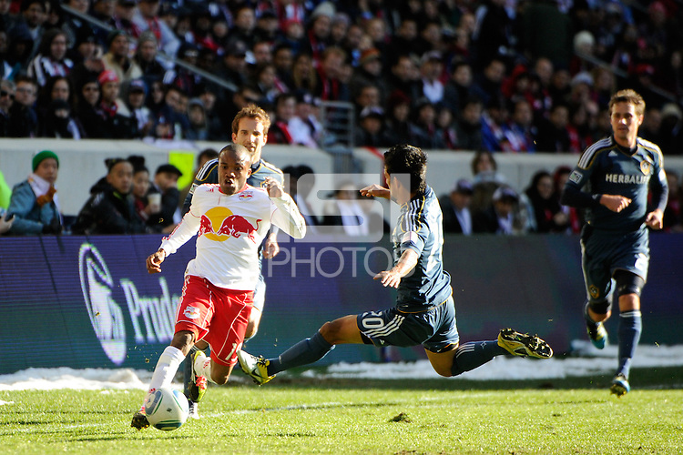 A.J. DeLaGarza (20) of the Los Angeles Galaxy goes for a tackle on Dane Richards (19) of the New York Red Bulls  during the 1st leg of the Major League Soccer (MLS) Western Conference Semifinals at Red Bull Arena in Harrison, NJ, on October 30, 2011.