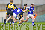 Brian Looney of Dr Crokes and Fionn Fitzgerald (6) and Cillian Duggan of Cratloe in the AIB Munster Senior Football Final played last Sunday in The Gaelic Grounds, Limerick.