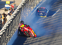 Feb 6, 2010; Daytona Beach, FL, USA; ARCA RE/MAX Series driver Jill George (48) flips over in front of Jesse Smith (29) during the Lucas Oil Slick Mist 200 at Daytona International Speedway. Mandatory Credit: Mark J. Rebilas-