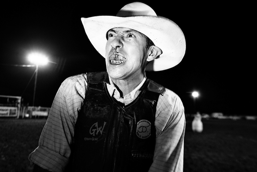 "Jimmy ""Stretch"" Borunda of San Antonio, Texas is injured during a bull ride in Johnson City, Texas.  August 16, 2008."