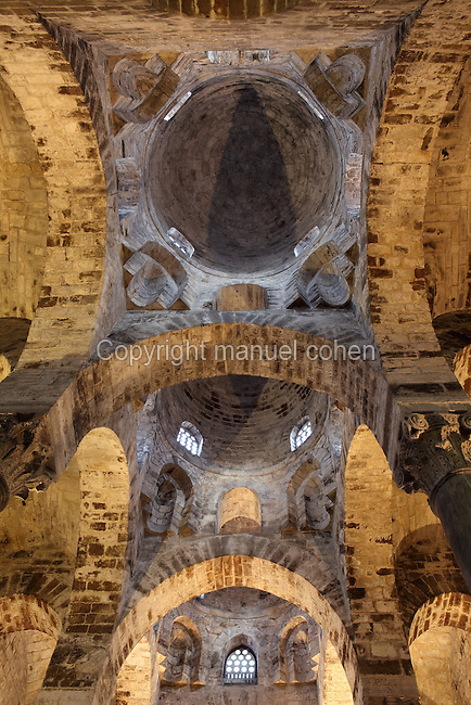 Interior low angle view of the three red domes, Chiesa di San Cataldo (Church of San Cataldo, La Cataldo), 1154, Palermo, Sicily, Italy. The Romanesque church with Arab influences was founded by Maio of Bari, chancellor to William I, during the Norman occupation of Sicily. Picture by Manuel Cohen