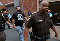 Charlottesville City Sheriff Deputies are forced to escort White Nationalist Matthew Heinbach away from a media frenzy outside Charlottesville District Court where James Alex Fields Jr., 20, of Maumee, Ohio, was arraigned on Monday. Heinbach blamed city and law enforcement officials for Saturday's violence. Photo/Andrew Shurtleff