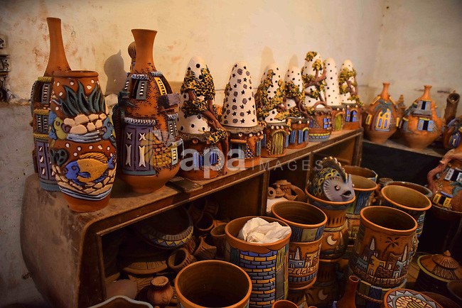 Pottery vessels are seen drying at a pottery workshop in Cairo, on July 24, 2016. Pottery is an ancient and traditional craft in Egypt. Local workshops usually produce products such as bowls, pitchers, flower pots, and vases. Photo by Amr Sayed