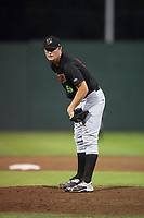 Great Falls Voyagers relief pitcher Chris Comito (19) looks in for the sign during a Pioneer League game against the Idaho Falls Chukars at Melaleuca Field on August 18, 2018 in Idaho Falls, Idaho. The Idaho Falls Chukars defeated the Great Falls Voyagers by a score of 6-5. (Zachary Lucy/Four Seam Images)