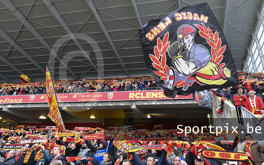 20191221 - LENS , FRANCE : illustration picture shows the fans in the Delacourt tribune pictured during the soccer match between Racing Club de LENS and Niort , on the 19 th matchday in the French Ligue 2 at the Stade Bollaert Delelis stadium , Lens . Saturday 21 December 2019. PHOTO DIRK VUYLSTEKE | SPORTPIX.BE