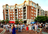 Crowds turn out for an Alive After Five event held at the Piedmont Town Center, a multi-tenant urban development near SouthPark mall. Billing itself as Charlotte's largest weekly happy hour, Alive After Five (AA5) expanded in 2012 to take place at the EpiCentre and Wells Fargo Plaza uptown and the Piedmont Town Center near SouthPark.