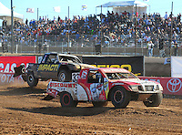 Apr 17, 2011; Surprise, AZ USA; LOORRS driver Jimmy Stephensen (33) leads Matt Loiodice (20) during round 4 at Speedworld Off Road Park. Mandatory Credit: Mark J. Rebilas-