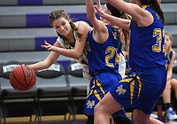 NWA Democrat-Gazette/J.T. WAMPLER Fayetteville's Kennedy Bobbitt makes a pass under pressure from Mountain Home's Anna Grace Foreman (RIGHT) and Emma Martin Tuesday Nov. 14, 2017. Fayetteville won 51-30.