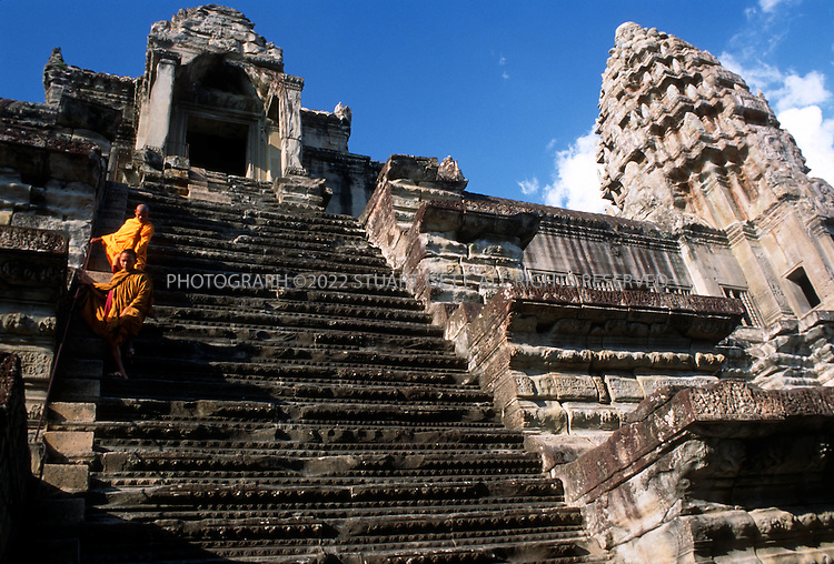 """4/20/2003--Angkor Wat Temples, Siem Reap, Cambodia..Angkor Wat. Angkor Wat is located about six kilometers (four miles) north of Siem Reap, south of Angkor Thom. ..Angkor Wat was built in the first half of the 12th century (113-5BC). Estimated construction time of the temple is 30 years by King Suryavarman II, dedicated to Vishnu (Hindu), replica of Angkor Thom style of art...BACKGROUND .Angkor Wat, the largest monument of the Angkor group and the best preserved, is an architectural masterpiece. Its perfection in composition, balance, proportions, relief's and sculpture make it one of the finest monuments in the world. ..Wat is the Thai name for temple (the French spelling is """"vat """"), which was probably added to """"Angkor """"when it became a Theravada Buddhist monument, most likely in the sixteenth century (for the etymology of the name 'Angkor' see page 17) After 1432 when the capital moved to Phnom Penh, Angkor Wat was cared for by Buddhist monks. ..It is generally accepted that Angkor Wat was a funerary temple for King Suryavarman II and oriented to the west to conform to the symbolism between the setting sun and death. The bas-reliefs, designed for viewing from left to right in the order of Hindu funereal ritual, support this function. ...All photographs ©2003 Stuart Isett.All rights reserved.This image may not be reproduced without expressed written permission from Stuart Isett."""