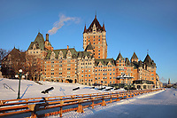 Chateau Frontenac, opened 1893, designed by Bruce Price as a chateau style hotel for the Canadian Pacific Railway company or CPR, seen from the Dufferin Terrace, in Quebec City, Quebec, Canada. The building was extended and the central tower added in 1924, by William Sutherland Maxwell. The building is now a hotel, the Fairmont Le Chateau Frontenac, and is listed as a National Historic Site of Canada. The Historic District of Old Quebec is listed as a UNESCO World Heritage Site. Picture by Manuel Cohen